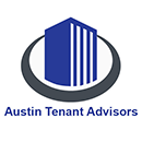 Austin Tenant Advisors logo. From a 45 degree angle, an icon of a blue building is encircled by a dark grey ring.