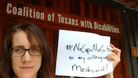 A woman with a furrowed brow and glasses holds by her face a white piece of paper that reads #NoCapsNoCuts to my colleagues' Medicaid. Behind her is a sign that reads Coalition of Texans with Disabilities.