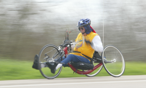 Male hand-cyclist on the road